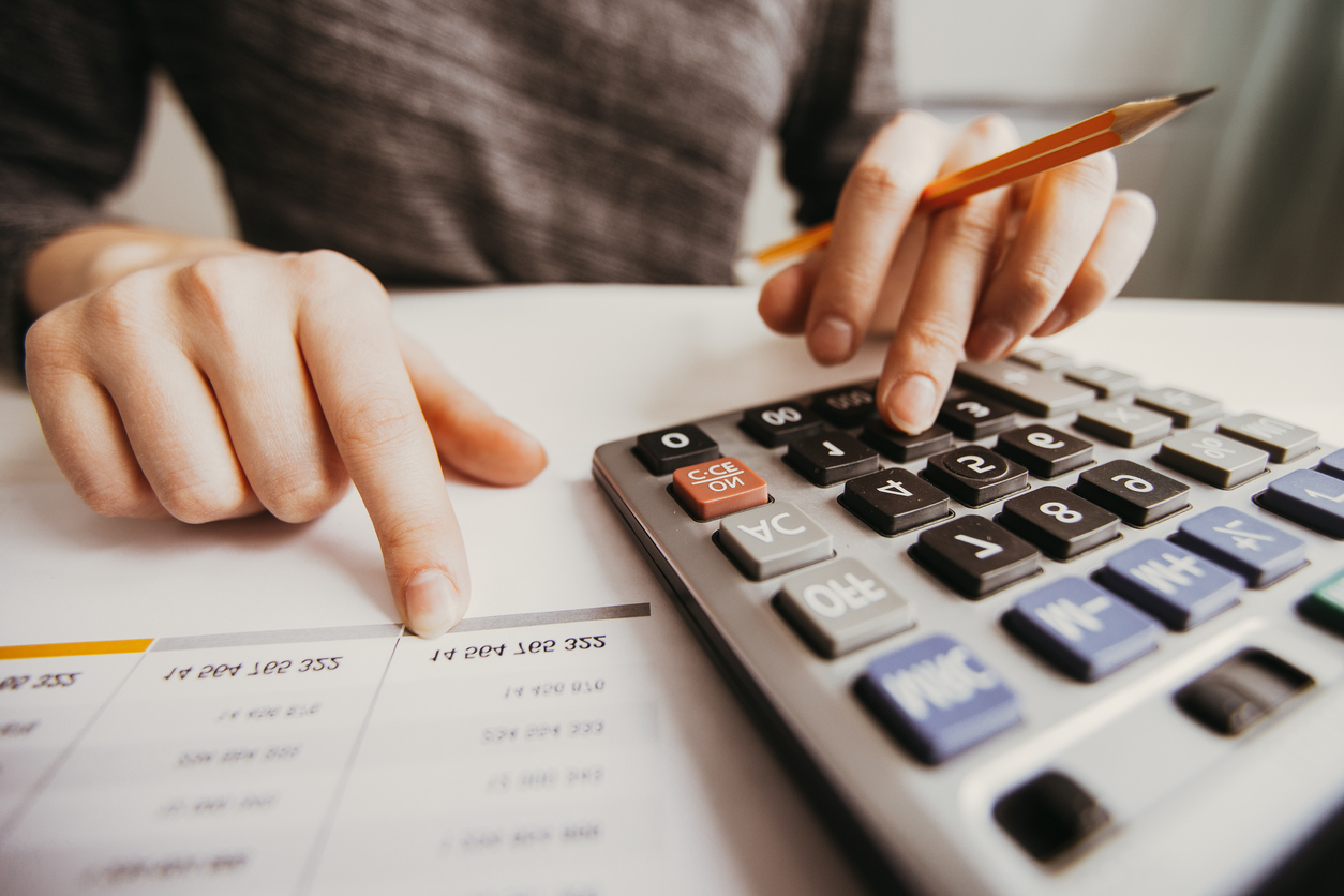 Accounting _ Closeup of Accountant Hands Counting on Calculator iStock_898962594.jpg