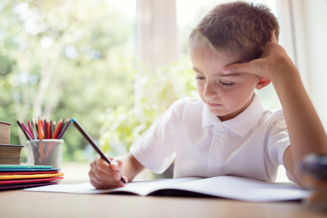English _ Boy doing his school work or homework  iStock_845847486.jpg