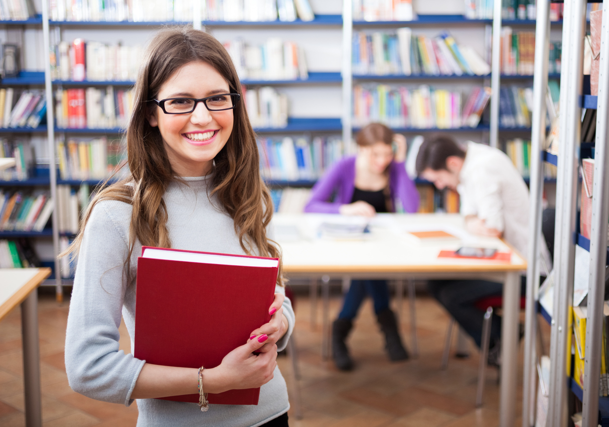 Expert Tutors _ Portrait of a student in the library iStock_510902781.jpg
